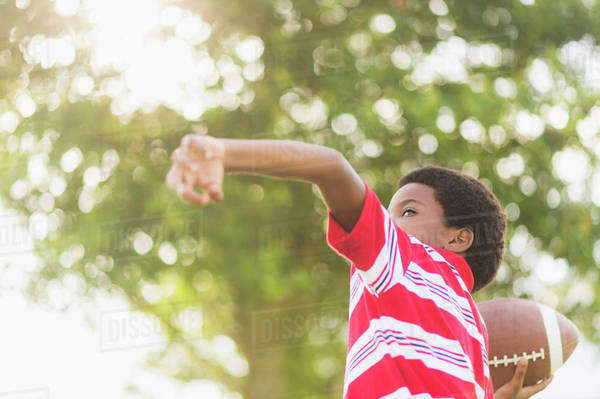Boy (6-7) playing football Royalty-free stock photo