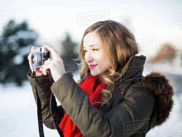 Woman photographing winter landscape Royalty-free stock photo