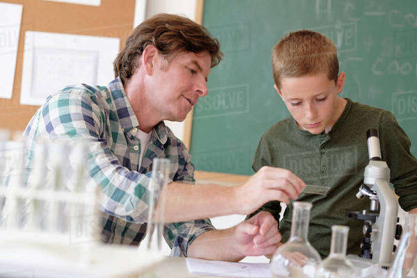 Teacher talking with student (8-9) in classroom Royalty-free stock photo