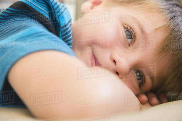 Boy (6-7) relaxing on sofa Royalty-free stock photo