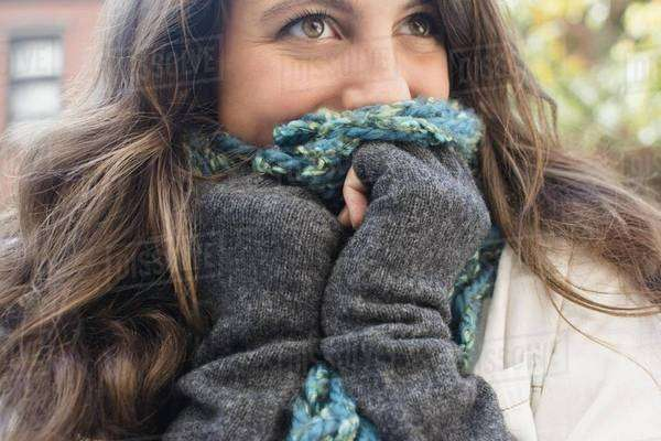 Young woman hiding her face behind scarf Royalty-free stock photo