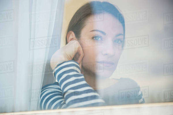 Woman looking through window Royalty-free stock photo