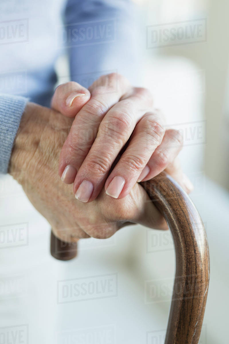 Close-up of hands of grandmother and granddaughter (16-17) Royalty-free stock photo