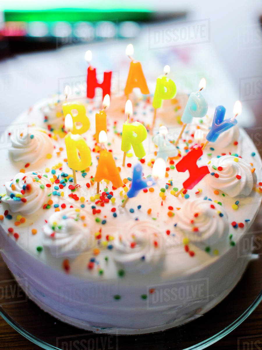 Birthday Cake On Table Stock Photo Dissolve