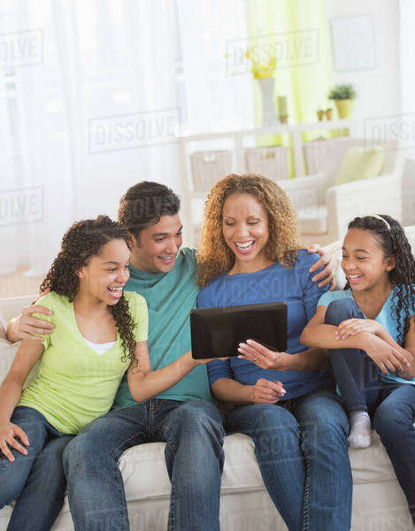 Parents with daughters (10-13) using tablet pc Royalty-free stock photo