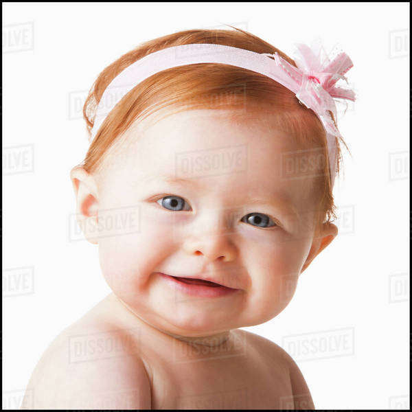 Portrait of baby girl (6-11 months) smiling, studio shot Royalty-free stock photo