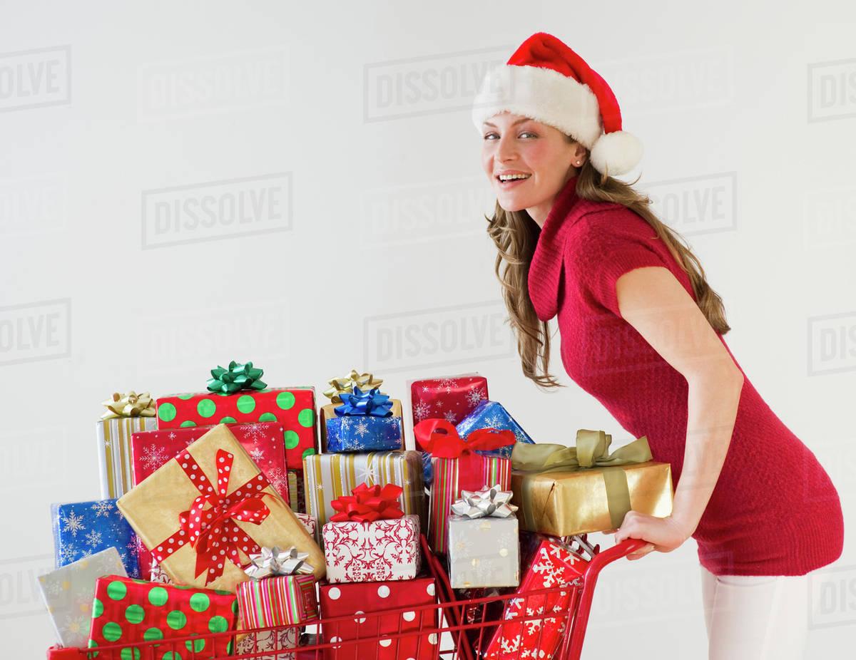 Shopping cart full of Christmas presents - Stock Photo - Dissolve