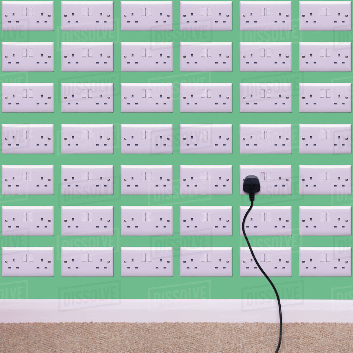 Wall covered in electrical outlets - Stock Photo - Dissolve