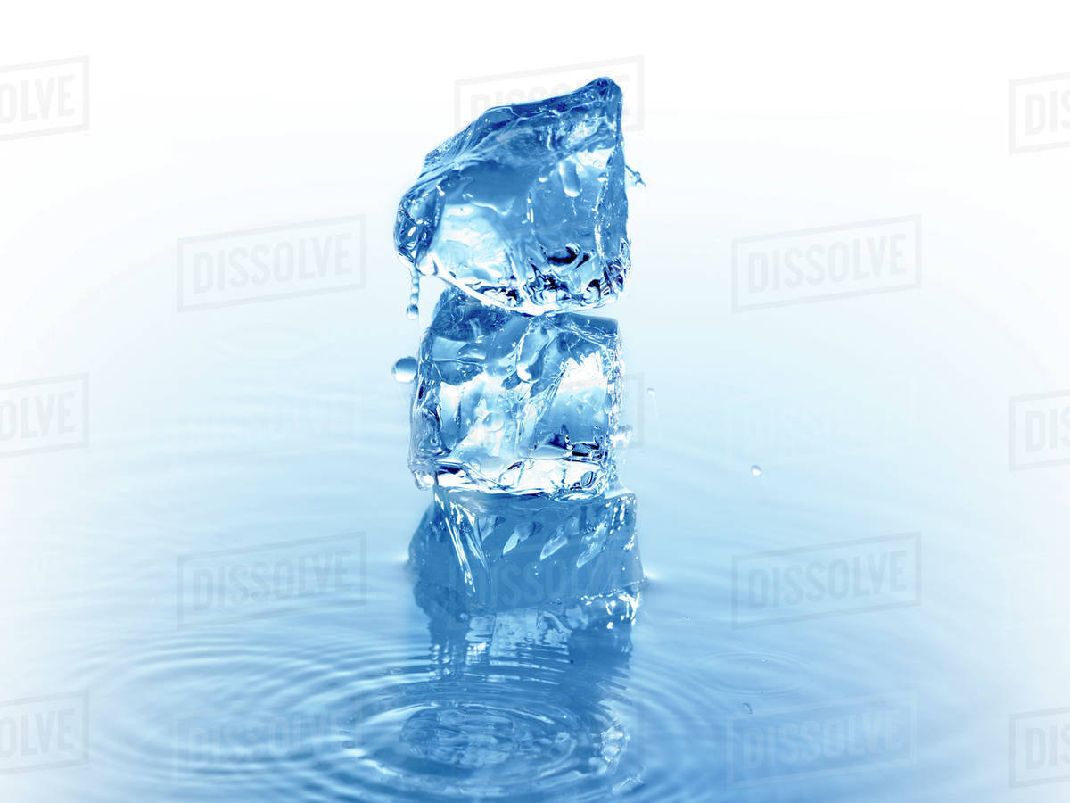 Stack Of Ice Cubes In Water Stock Photo Dissolve