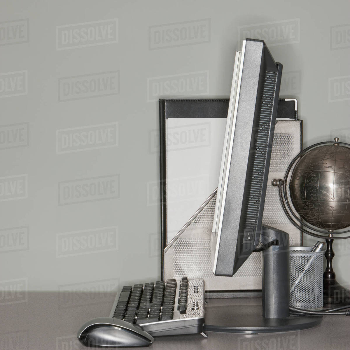 Computer And Globe On Office Desk