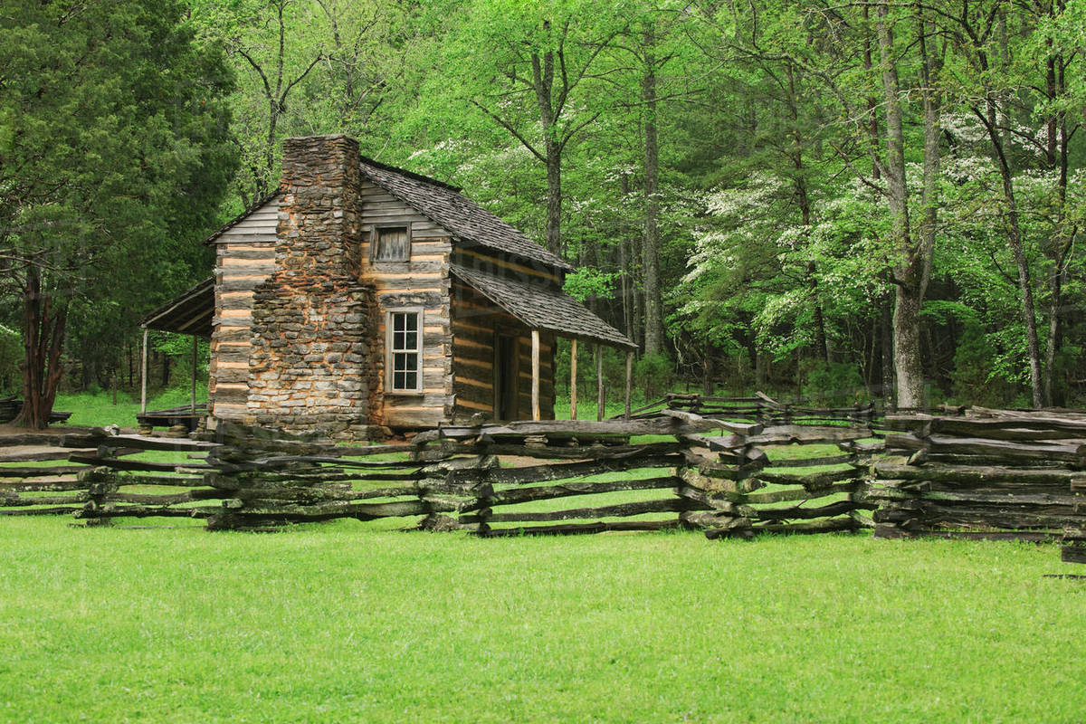 A Fence And Cabin In Smoky Mountain National Park Stock Photo