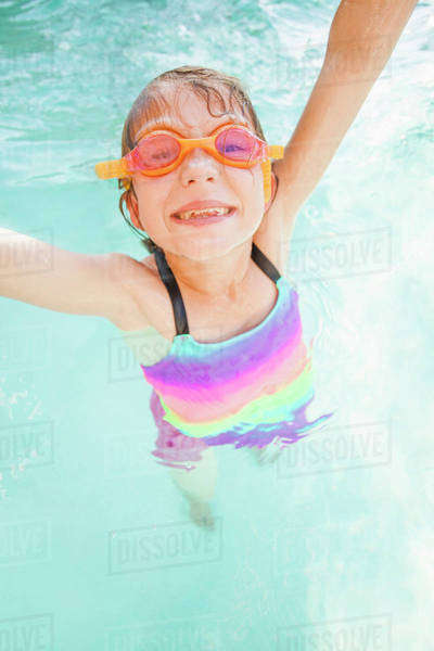 Girl (8-9) playing in swimming pool Royalty-free stock photo