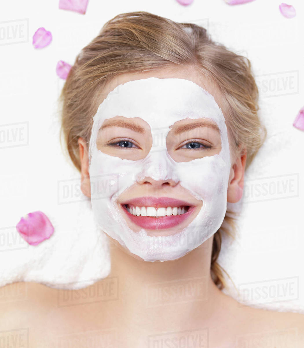 Young Woman Getting Facial Spa Treatment Stock Photo Dissolve