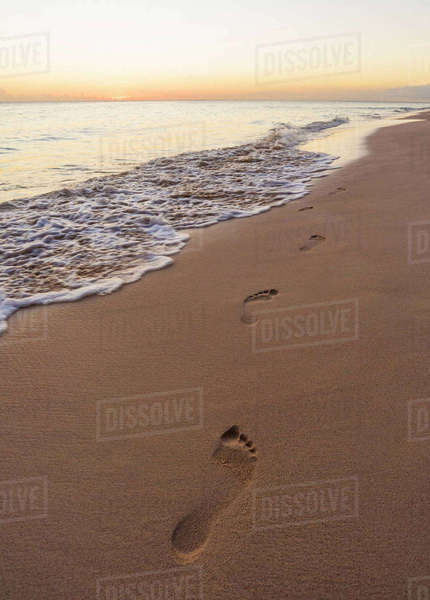 Footprints on sand on tropical beach Royalty-free stock photo