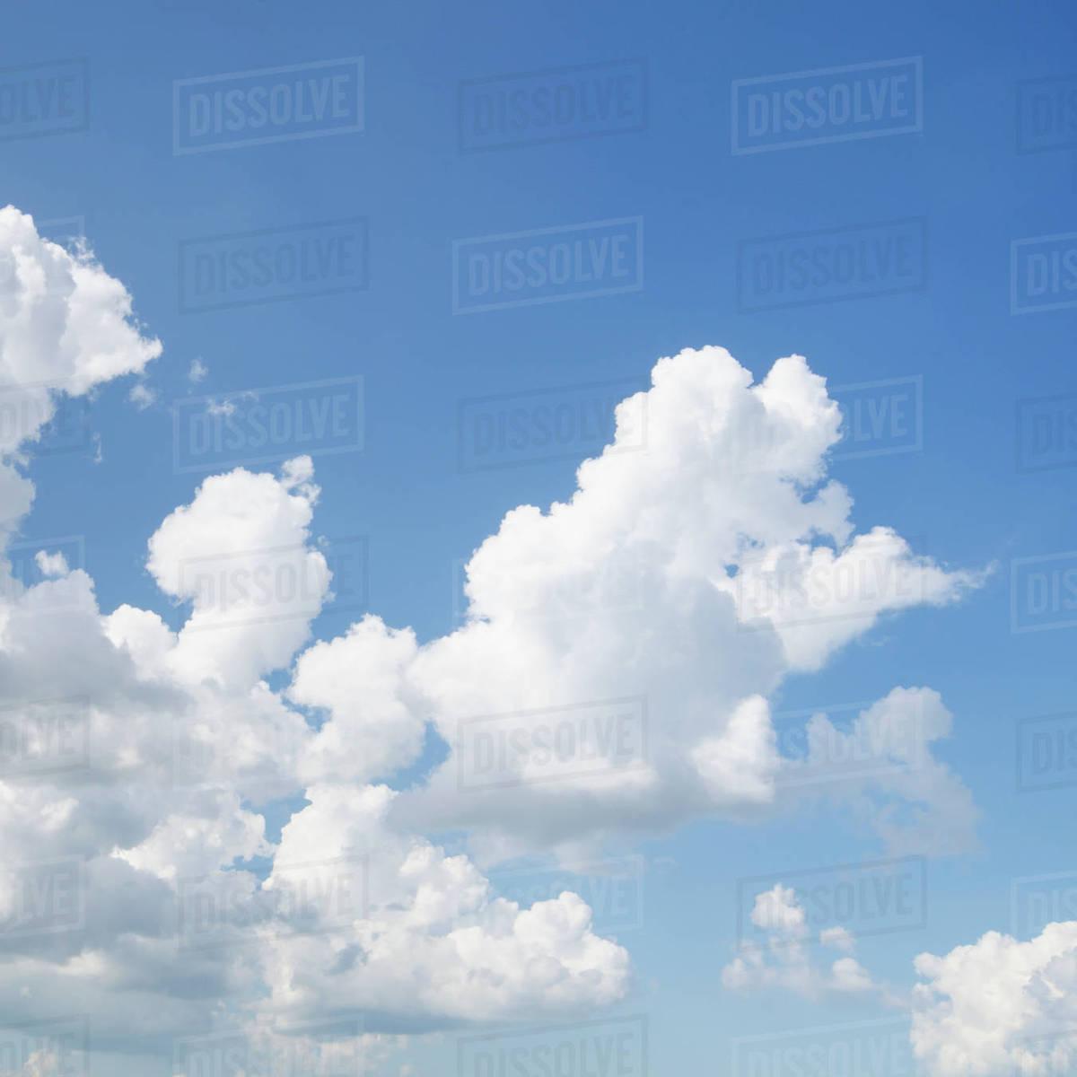 cumulus clouds in blue sky stock photo dissolve