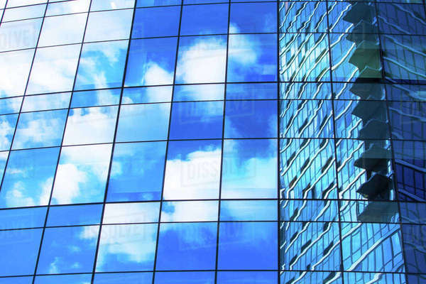 USA, New York, Clouds reflecting in glassy office building Royalty-free stock photo