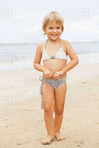 Portrait of girl (2-3) standing on beach Royalty-free stock photo