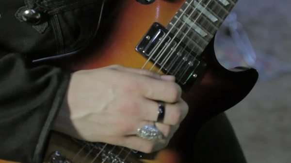 Close-up shot of person playing the guitar Royalty-free stock video