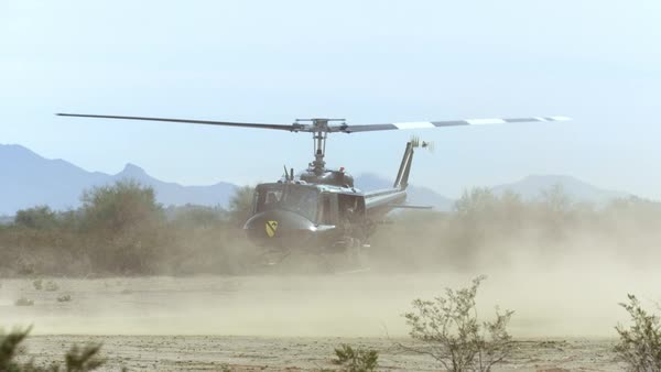 Huey helicopter taking off from the desert, in slow motion Royalty-free stock video