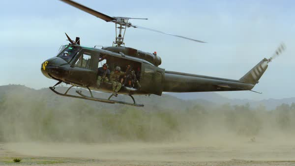 Huey helicopter lands in the desert, slow motion. Royalty-free stock video