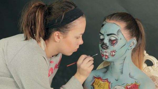 Makeup Artist Putting Zombie On