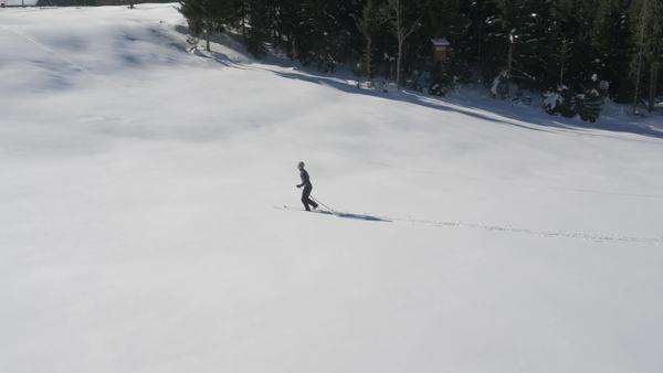 Aerial - Young man ski running Royalty-free stock video