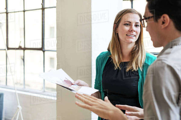 Business people discussing over documents at office Royalty-free stock photo