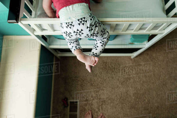 Low section of boy climbing bunkbed in bedroom Royalty-free stock photo