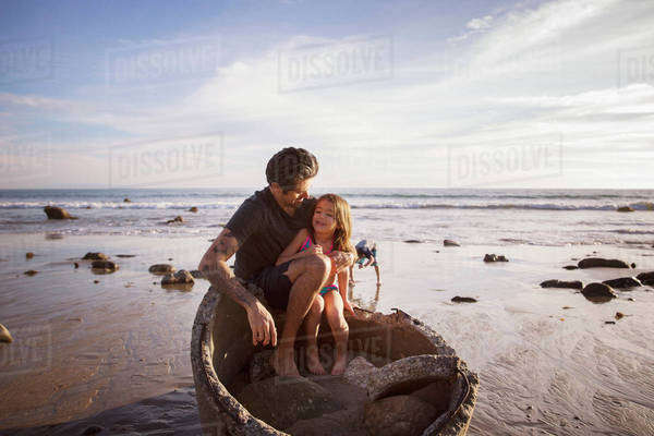 Father and daughter (5-6) having fun on beach Royalty-free stock photo
