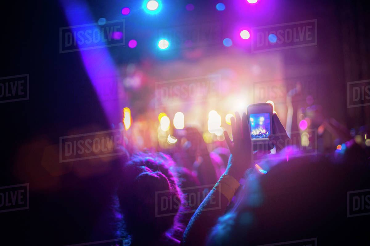 Person taking photo of rock concert with smartphone Royalty-free stock photo