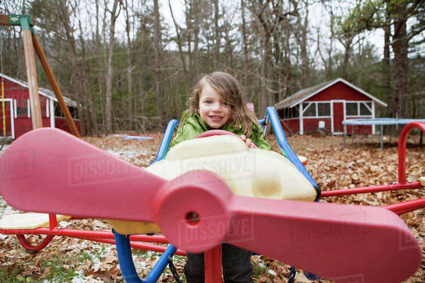 Portrait of boy sitting in model airplane at park Royalty-free stock photo
