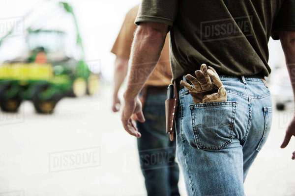 Midsection of farm workers walking at field Royalty-free stock photo