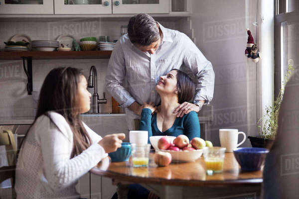 Happy family having breakfast at table in kitchen Royalty-free stock photo