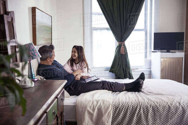 Happy father with daughter on bed at home Royalty-free stock photo
