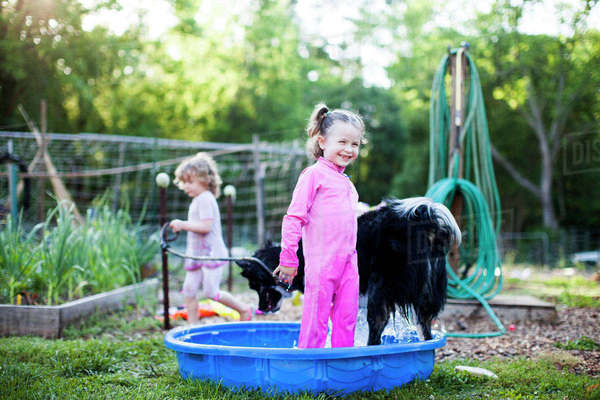Girls with dog in yard Royalty-free stock photo