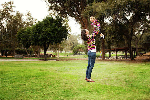 Mother playing with daughter (12-17 months) in park Royalty-free stock photo