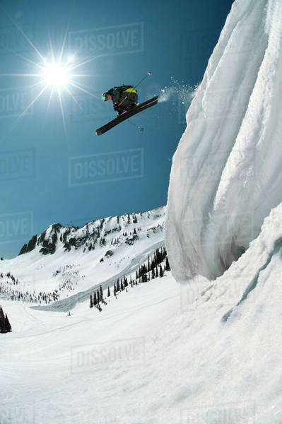 Skier jumping off mountain Royalty-free stock photo
