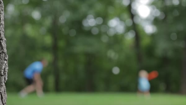 Defocussed shot of father and son playing baseball at yard Royalty-free stock video