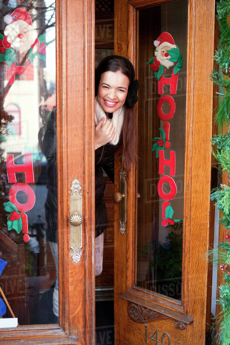 opening front door. Woman Opening Front Door For Holiday Visitors H