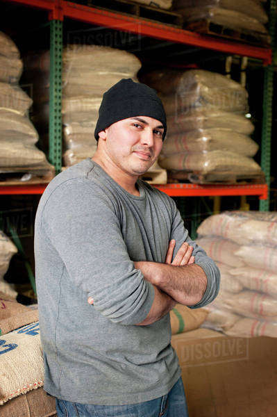 Man in cap in coffee bean warehouse Royalty-free stock photo