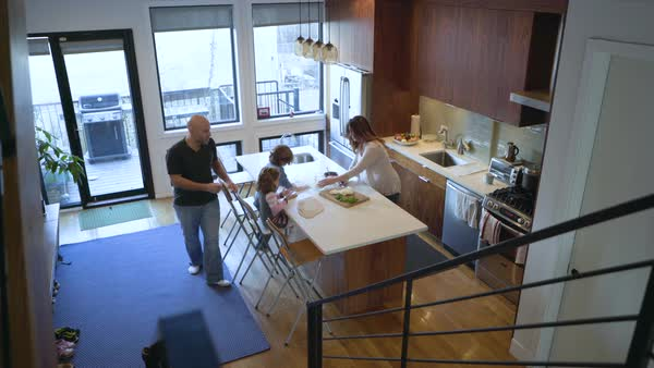 High angle dolly shot of family preparing food in kitchen Royalty-free stock video