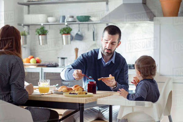 Family having breakfast in kitchen at home Royalty-free stock photo