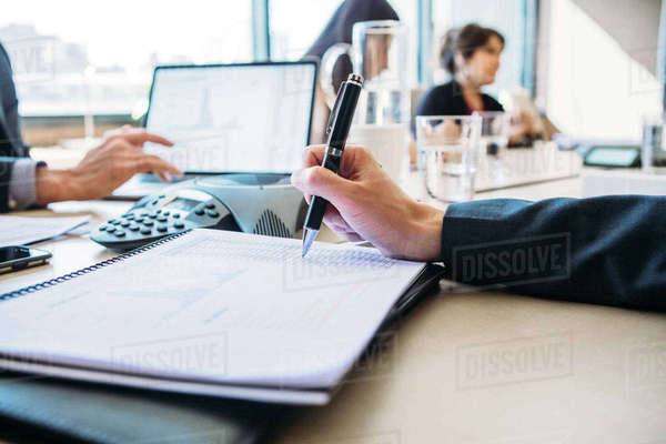 Colleagues discussing in board room Royalty-free stock photo