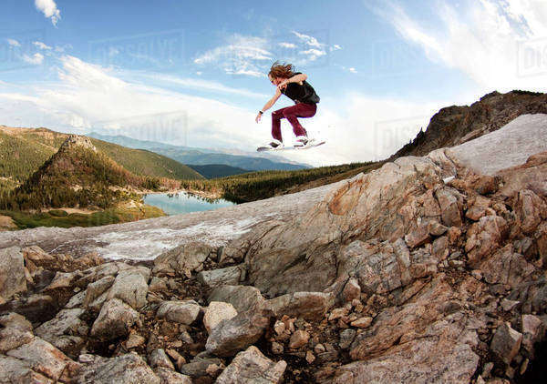 Snowboarder Jumping in Extreme Conditions Royalty-free stock photo