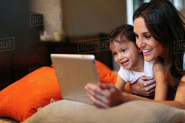 Happy mother with daughter looking at tablet computer Royalty-free stock photo