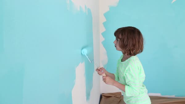 Handheld shot of girl painting with roller on wall at home Royalty-free stock video