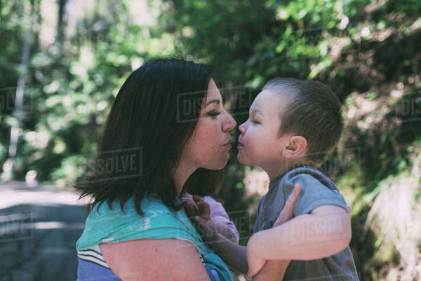 Side view of mother and son about to kiss at park Royalty-free stock photo