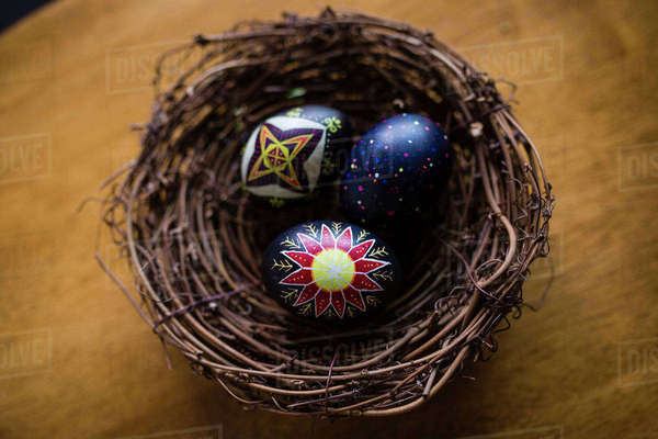 High angle view of Easter eggs in nest on wooden table Royalty-free stock photo