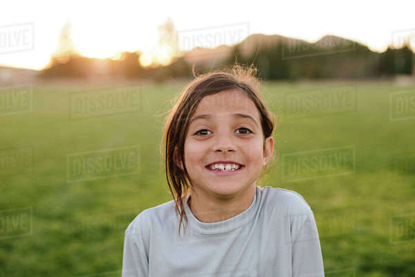 Portrait of happy girl at playground during sunset Royalty-free stock photo