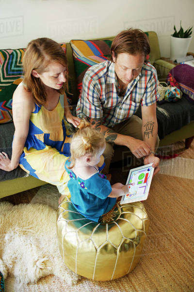 Father showing digital tablet to daughter (18-23 months) Royalty-free stock photo